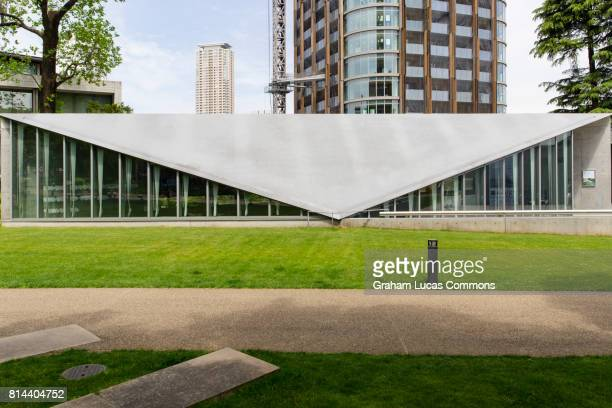exterior of 21_21 design sight gallery designed by japanese architect tadao ando in tokyo midtown, japan. - tadao ando stock photos and pictures
