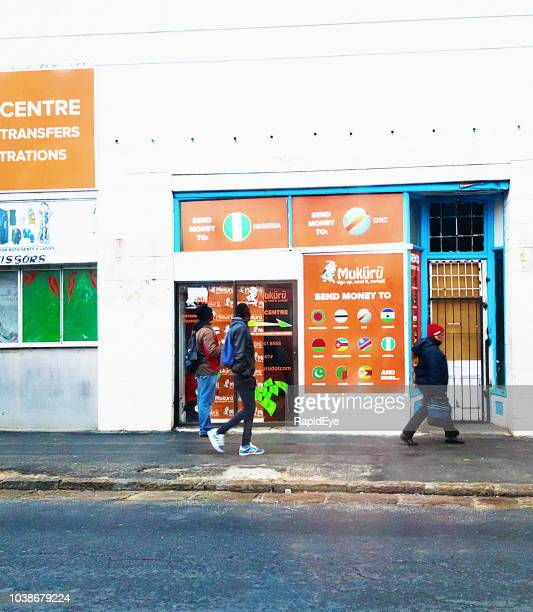 exterior of a makuru money-transfer store in cape town - money transfer stock pictures, royalty-free photos & images