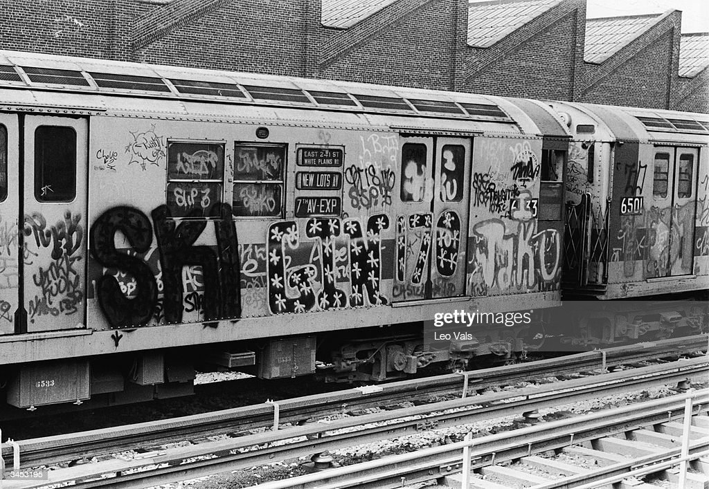 Exterior of a subway car covered with graffiti, New York City, 1970s.