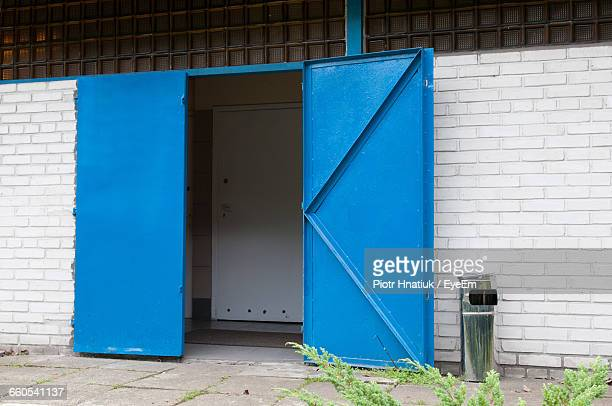 exterior of brick building with blue doors - piotr hnatiuk ストックフォトと画像