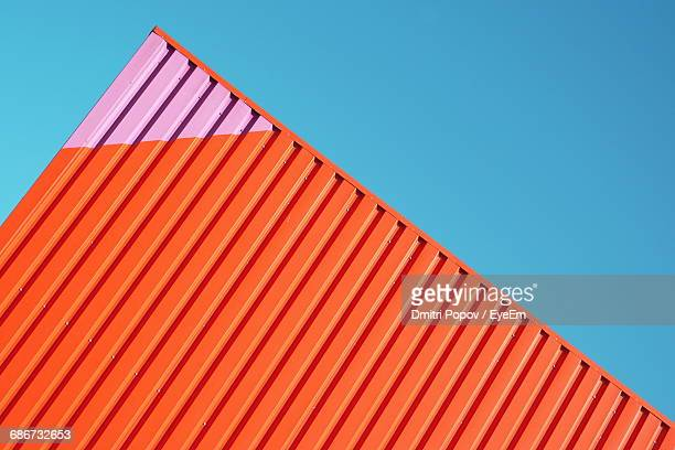 exterior of building against clear blue sky - orange farbe stock-fotos und bilder