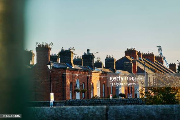 exterior of building against clear sky - focus on background stock pictures, royalty-free photos & images