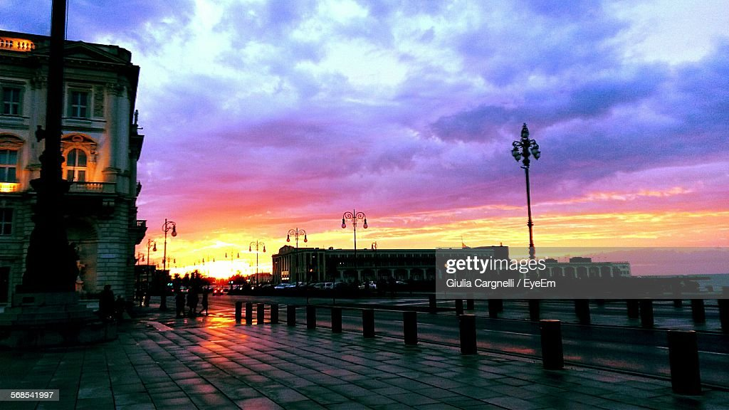 Exterior Of Building By Street Against Sky At Sunset : Stock Photo
