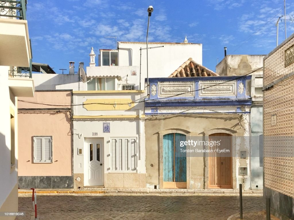 Exterior Of Buildings In Town Against Sky : Stock Photo