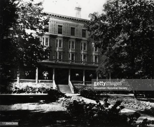 Exterior of Chadbourne Hall on the University of WisconsinMadison Madison Wisconsin 1922 Fourstory dormitory with a porch and hanging potted plants