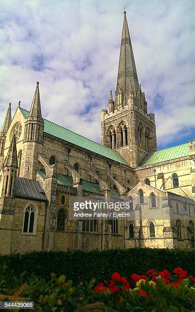Exterior Of Chichester Cathedral Against Cloudy Sky