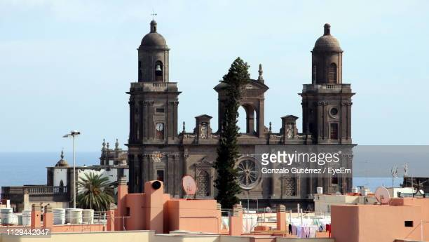 exterior of church against blue sky - las palmas cathedral stock photos and pictures