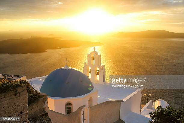Exterior Of Church At Santorini By Sea Against Sky During Sunset