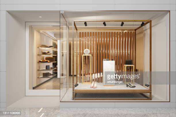 exterior of clothing store with shoes and other accessories displaying in showcase - luxury stock pictures, royalty-free photos & images