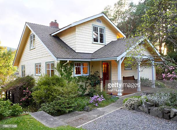 exterior of cottage style house with front yard - buildings stock pictures, royalty-free photos & images