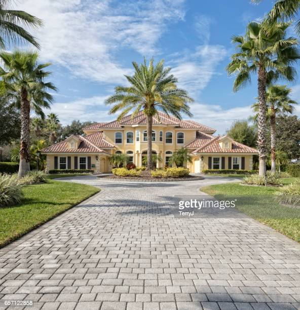 exterior of estate home with paver driveway - paver driveway stock pictures, royalty-free photos & images