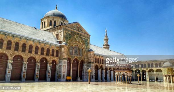 exterior of historic building against clear blue sky - damascus stock pictures, royalty-free photos & images