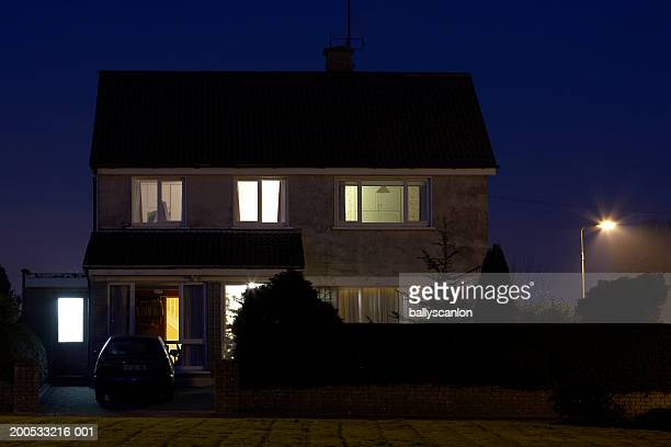 exterior of house, dusk - illuminate stock photos and pictures