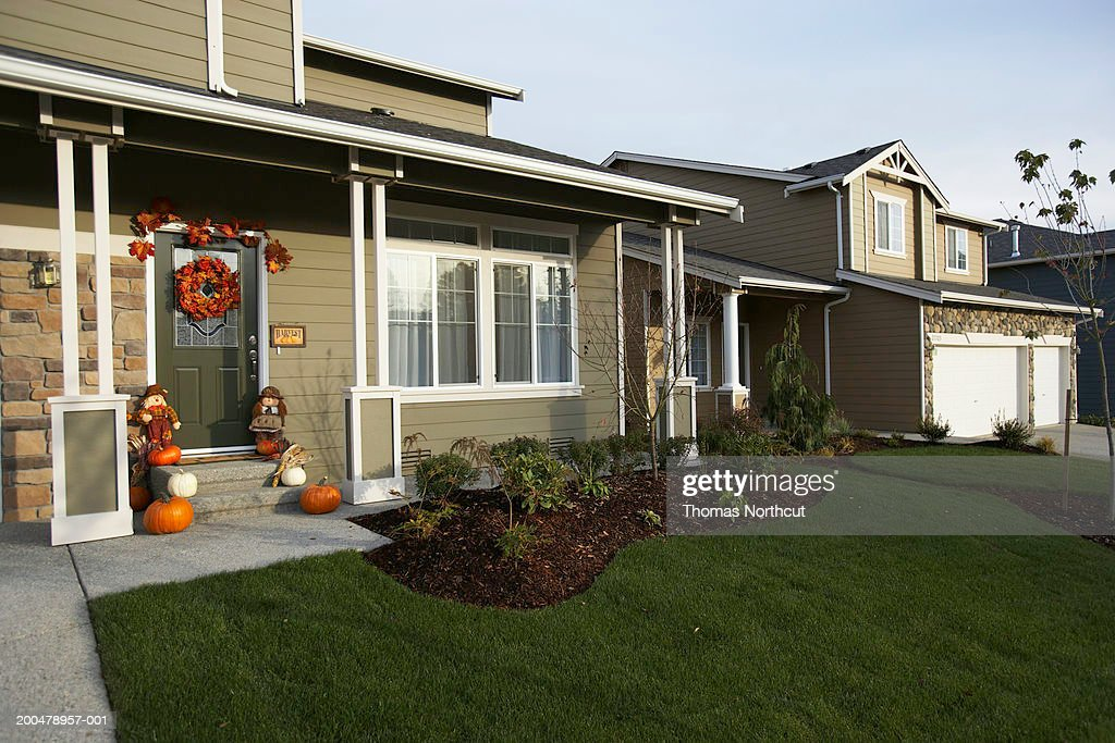 Exterior Of House With Halloween Decorations On Front Porch Stock