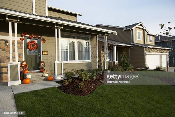 Exterior of house with Halloween decorations on front porch