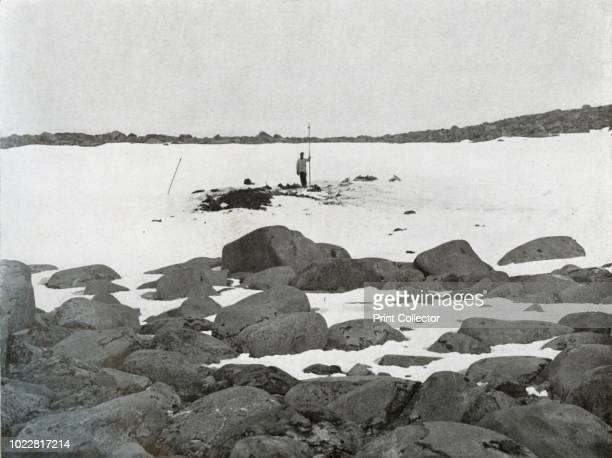 Exterior of Igloo The dark heap on the left consists of old seal bones and refuse thrown out by the party below' circa 1911 The final expedition of...