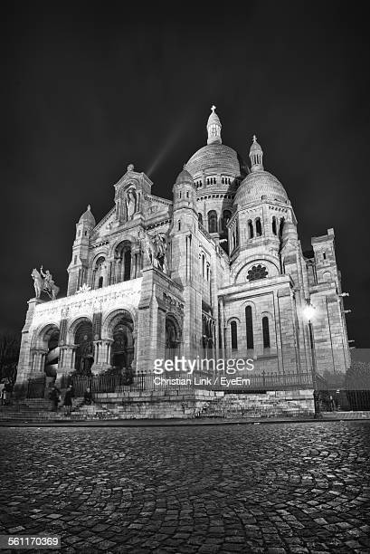 Exterior Of Illuminated Sacre-Coeur Against Clear Sky At Night