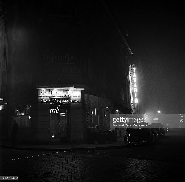 Exterior of Le Can Can bar and the Tabarin nightclub on a foggy street at night on November 1 1948 in Paris France