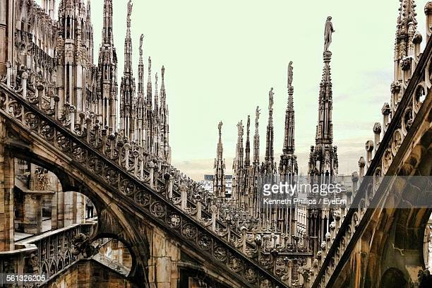 exterior of milan cathedral against sky - cattedrale foto e immagini stock