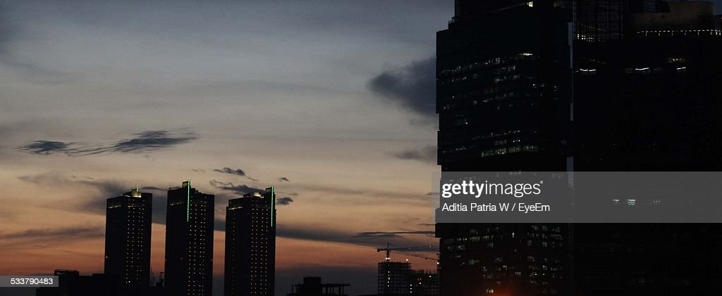 Exterior Of Modern Buildings Against Sky At Sunset : Foto stock