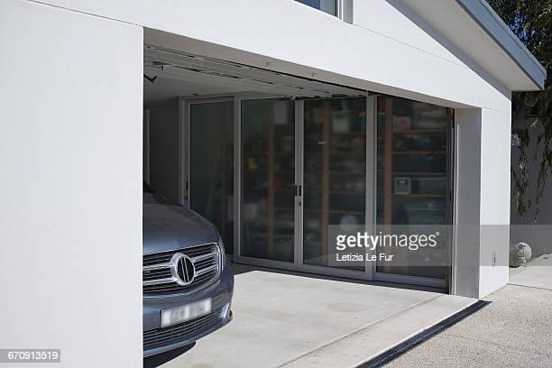 exterior of modern car garage - autobergplaats stockfoto's en -beelden