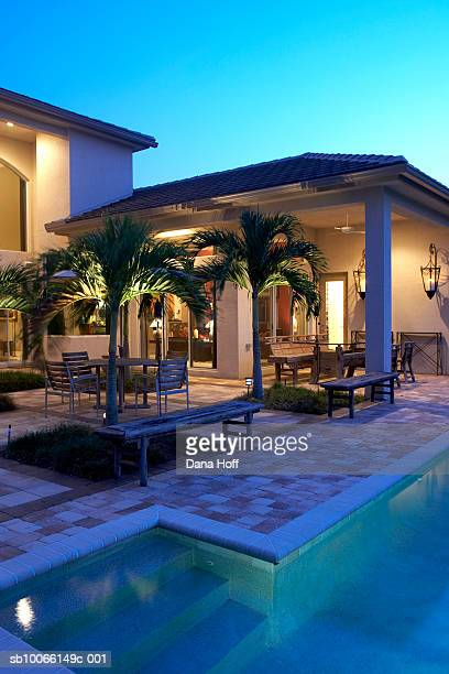 exterior of modern house and swimming pool at sunset - jupiter florida stock pictures, royalty-free photos & images