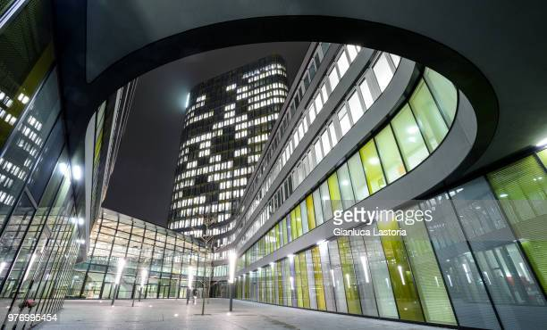 exterior of modern illuminated building, munich, bavaria, germany - bürogebäude stock-fotos und bilder