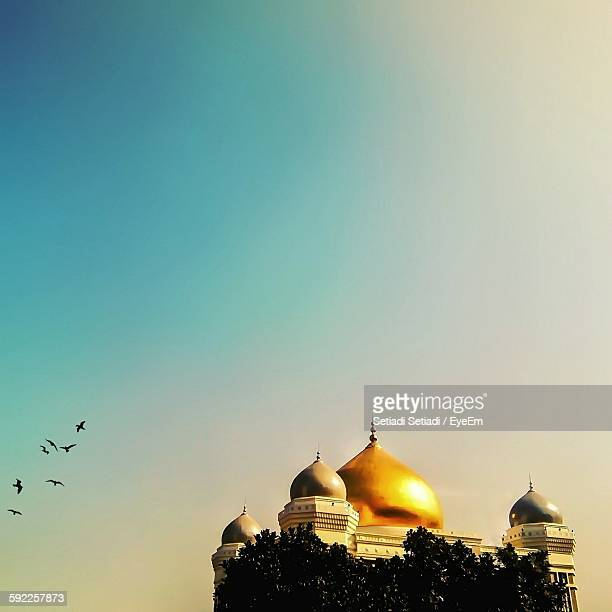 exterior of mosque against clear sky - java stock pictures, royalty-free photos & images