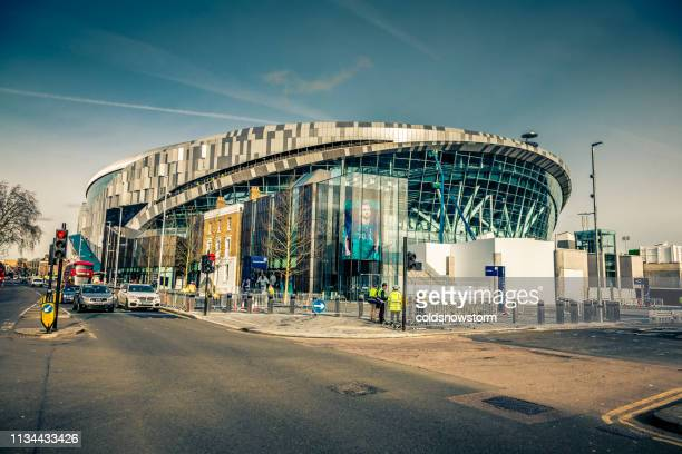 exterior of new tottenham hotspur stadium in london, uk - spurs stock photos and pictures