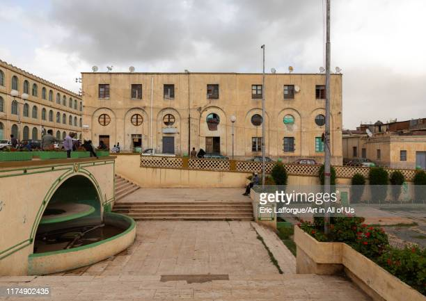 Exterior of old novecento style building and a fountain from the italian colonial times, Central region, Asmara, Eritrea on August 17, 2019 in...