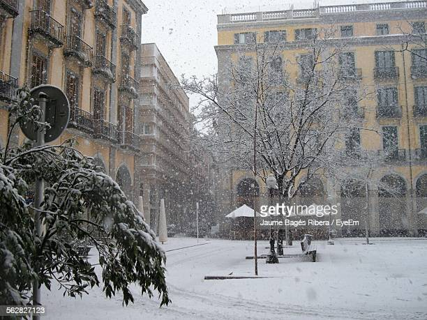 Exterior Of Residential Buildings During Snowfall