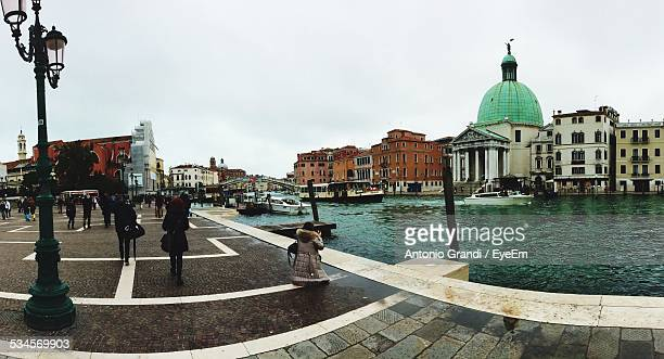 exterior of san simeone piccolo by canal against sky - simeone stock pictures, royalty-free photos & images