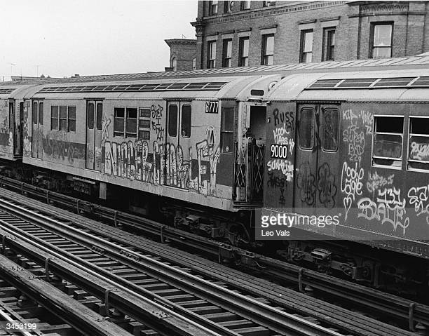 Exterior of subway cars painted with graffiti New York City 1970s