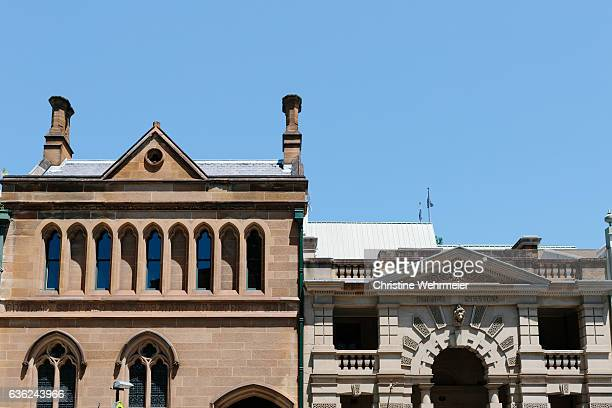 exterior of sydney's police station and bank on george street in the rocks, sydney, australia. - christine wehrmeier stock photos and pictures