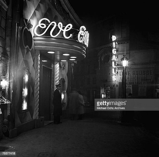 Exterior of the Eve and Pigalls nightclubs with the doorman out front on a foggy street at night on November 1 1948 in Paris France