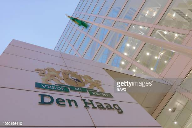 exterior of the hague's modern city hall at dusk - town hall stock pictures, royalty-free photos & images