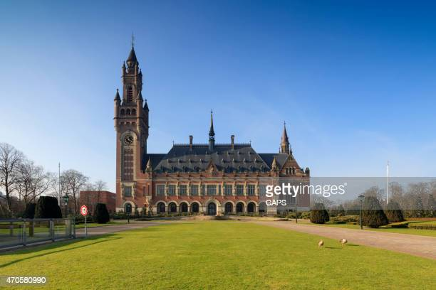 exterior of the hague's peace palace - hague stock photos and pictures