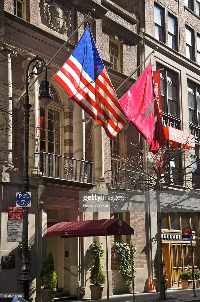 Exterior of The Harvard Club of New York City with flags flying above canopy New York NY USA & Exterior Of The Harvard Club Of New York City With Flags Flying ...