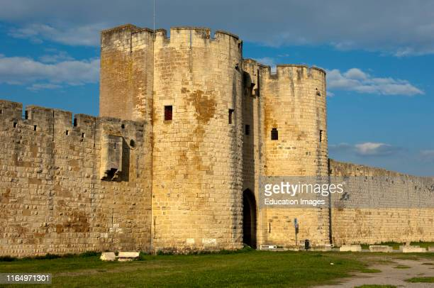 Exterior of the impressive town wall with a town gate, Aigues-Mortes, region Languedoc-Roussillon, France.