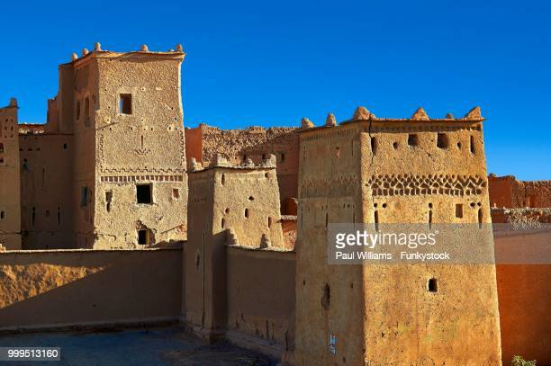 exterior of the mud brick taourirt kasbah built by pasha glaoui, unesco world heritage site, ouarzazate, morocco - kasbah of taourirt stock pictures, royalty-free photos & images