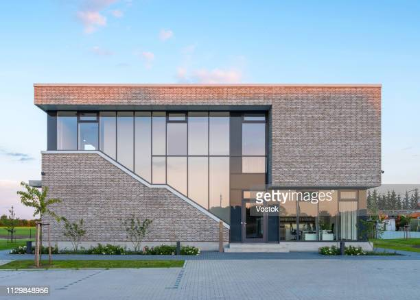 exterior of the office building in germany - gebäudefront stock-fotos und bilder