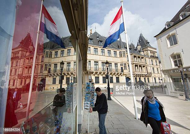 Exterior of the Palace of the Grand Dukes is reflected in a shop window as well as the Dutch national flag as Luxembourg prepares for the visit of...