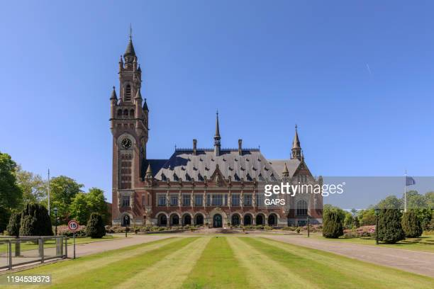 exterior of the peace palace in the hague - international court of justice stock pictures, royalty-free photos & images