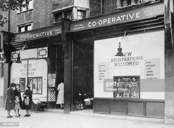 Exterior of the Royal Arsenal Cooperative Society Ltd Old Kent Road London 1946 A group of women chat outside The windows advertise for new...