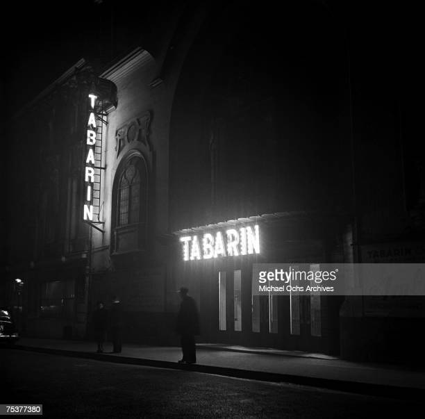 Exterior of the Tabarin nightclub with the doorman out front on a foggy street at night on November 1 1948 in Paris France