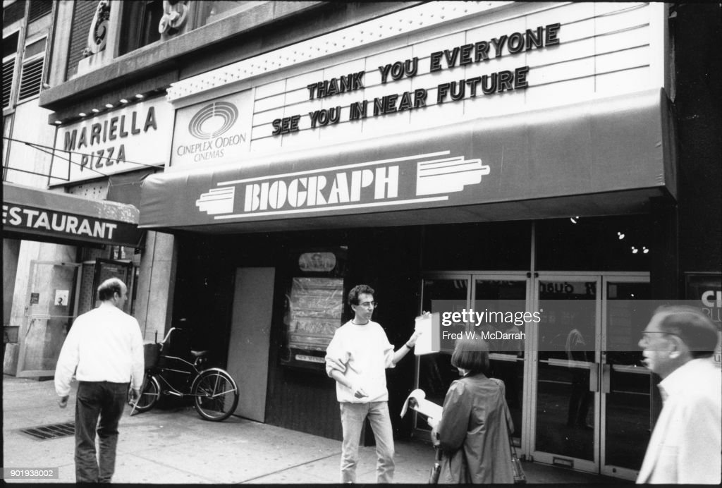 Exterior of view of the Biograph Cinema (at 225 West 57th Street), New York, New York, October 9, 1991. It closed on September 21, 1991, after previously being known as the Lincoln Art Theatre and the Bombay Cinema; it later reopened as the Angelika 57, before it's final demolition in 1997.
