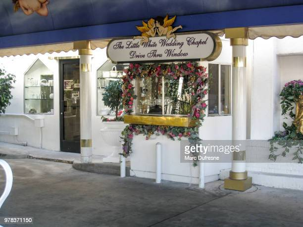 exterior of wedding chapel drive-in where you can get married staying in your car in vegas - chapel stock pictures, royalty-free photos & images