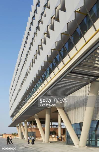 Exterior perspective with V-pylons. Siemens Masdar, Abu Dhabi, United Arab Emirates. Architect: Sheppard Robson, 2014.