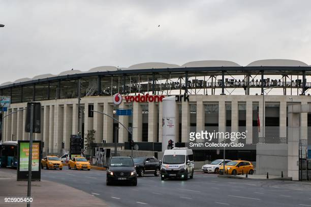 Exterior photograph of Vodafone Park a large sports arena and museum Istanbul Turkey with city traffic visible in the foreground November 15 2017