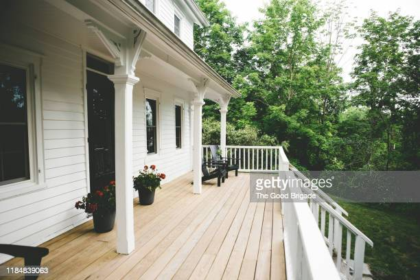 exterior shot of front porch at old farmhouse - house exterior stock pictures, royalty-free photos & images